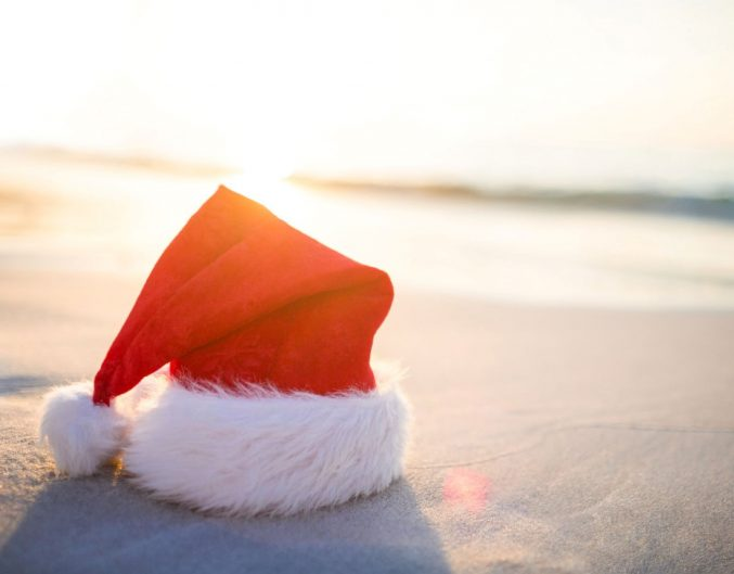 a Santa hat on the beach